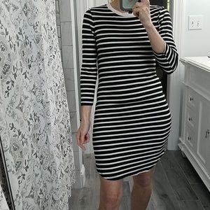 Monteau black and white striped bodycon dress.